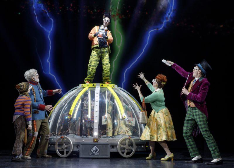 Mike Teavee jumps on top of Wonka's machine to shrink himself.