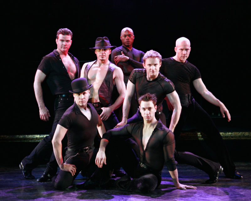 The men of the company of Broadway's CHICAGO pose center stage.